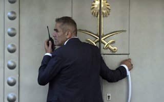 epa07082520 An official stands in front of the Saudi consulate in Istanbul, Turkey, 10 October 2018. Turkish President Recep Tayyip Erdogan on 07 October said he is following the developments on the disappearance of Saudi journalist Jamal Khashoggi, who has gone missing after visiting the Saudi consulate in Istanbul on 02 October to complete routine paperwork.  EPA/SEDAT SUNA