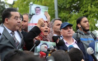 epa07078540 Yemeni Nobel Prize winner Tawakkol Karman (C) and Egyptian dissident politician Ayman Nour (L) participate in a demonstration for missing Saudi journalist Jamal Khashoggi organized by Turkish-Arabic Media Association in front of the Saudi consulate in front of the Saudi consulate in Istanbul, Turkey, 08 October 2018. Turkish President Recep Tayyip Erdogan on 07 October said he is following the developments on the disappearance of Saudi journalist Jamal Khashoggi who has gone missing after visiting the Saudi consulate in Istanbul on 02 October to complete routine paperwork.  EPA/TOLGA BOZOGLU