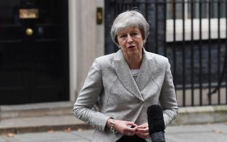 epa07182818 British Prime Minister Theresa May delivering a statement to the press outside 10 Downing Street in London, Britain, 22 November 2018. Prime Minister Theresa May has held an emergency Brexit cabinet meeting seeking to sell her Brexit deal to her cabinet ministers.  EPA/ANDY RAIN