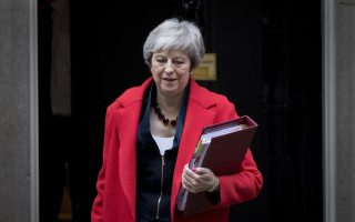 epa07194556 British Prime Minister Theresa May leaves No.10 Downing Street as she makes her way to The House of Commons for Prime Minister's Questions, Central London, Britain, 28 November 2018. Later the Prime Minister will visit Scotland as she tries to build support for her Brexit deal before the vote next month in the Commons.  EPA/RICK FINDLER