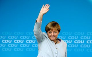 German Chancellor and chairwoman of the Christian Democratic Union (CDU) Angela Merkel waves during an election campaign rally for local city elections in Berlin, Germany, September 14, 2016.    REUTERS/Fabrizio Bensch