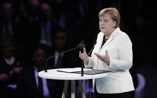 German Chancellor Angela Merkel speaks at the opening session of the Paris Peace Forum as part of the commemoration ceremony for Armistice Day, in Paris, Sunday, Nov. 11, 2018. International leaders attended a ceremony in Paris on Sunday at mark the 100th anniversary of the end of World War I. (Yoan Valat, Pool via AP)