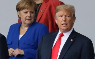German Chancellor Angela Merkel and U.S. President Donald Trump are seen as they pose for a family photo at the start of the NATO summit in Brussels, Belgium July 11, 2018.   REUTERS/Reinhard Krause