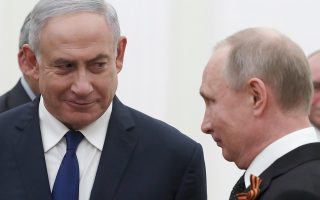 Russian President Vladimir Putin, right, and Israeli Prime Minister Benjamin Netanyahu talk to each other during their meeting in the Kremlin in Moscow, Russia, Wednesday, May 9, 2018. (Sergei Ilnitsky/Pool Photo via AP)