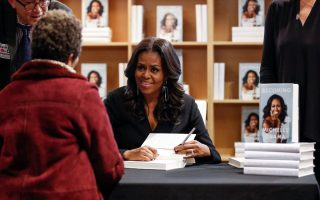 Former first lady Michelle Obama signs copies of her memoir