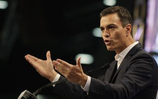 Spain's Prime Minister Pedro Sanchez delivers his speech during a forum organized by the Democratic Party, in Milan, Italy, Saturday, Oct. 27, 2018. (AP Photo/Luca Bruno)