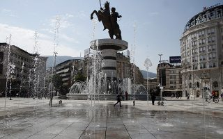 A boy plays at a fountain in front of the statue during a referendum in Skopje, Macedonia, Sunday, Sept. 30, 2018. Macedonians were deciding Sunday on their country's future, voting in a crucial referendum on whether to accept a landmark deal ending a decades-old dispute with neighbouring Greece by changing their country's name to North Macedonia, to qualify for NATO membership and also pave its way toward the European Union. (AP Photo/Thanassis Stavrakis)