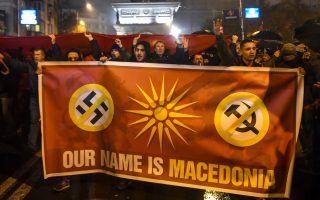 epa07175848 Supporters of the movement 'boycotting' hold a banner during the protest against the changing the constitution and the country's name to the Republic of North Macedonia in front of the Parliament building in Skopje, The Former Yugoslav Republic of Macedonia, 18 November 2018. They are protesting against Government politics and over compromise solution in Macedonia's dispute with Greece over the country's name. The agreement is key for Macedonia's NATO and EU accession process.  EPA/GEORGI LICOVSKI