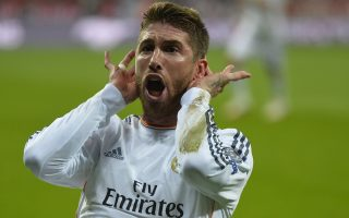 Real Madrid's defender Sergio Ramos celebrates after scoring the 0-2 during the UEFA Champions League second-leg semi-final football match FC Bayern Munich vs Real Madrid CF in Munich, southern Germany, on April 29, 2014.   AFP PHOTO / ODD ANDERSEN