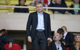 President of AS Monaco Dmitry Rybolovlev attends the French League One soccer match Monaco against Saint Etienne, in Monaco stadium, Saturday, Oct. 5, 2013. (AP Photo/Lionel Cironneau)