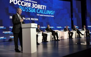 Russian President Vladimir Putin delivers a speech during a session of the VTB Capital Investment Forum