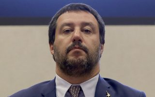 Interior Minister Matteo Salvini answers reporters' questions during a press conference at the Interior Ministry in Rome, Wednesday, Nov. 7, 2018. (AP Photo/Alessandra Tarantino)