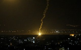 Flares fired from Israeli forces light up the night sky in Gaza City, Monday, Nov. 12, 2018, as the Israeli military launched fighter jets to strike