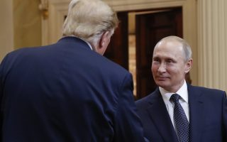 U.S. President Donald Trump, left, and Russian President Vladimir Putin, right, shake hands at the conclusion of their joint news conference at the Presidential Palace in Helsinki, Finland, Monday, July 16, 2018. (AP Photo/Pablo Martinez Monsivais)