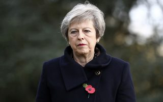 Britain's Prime Minister Theresa May prior to laying wreaths at the graves of John Parr, the first British soldier to be killed in WWI in 1914, and George Ellison, the last to be killed before Armistice in 1918, at the St Symphorien Military Cemetery in Mons, Friday Nov. 9, 2018. (Gareth Fuller/Pool via AP)