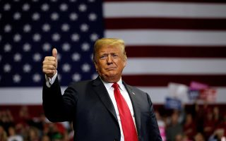 FILE PHOTO: U.S. President Donald Trump gestures to supporters during a campaign rally at the Allen County War Memorial Coliseum in Fort Wayne, Indiana, U.S., November 5, 2018.  REUTERS/Carlos Barria/File Photo