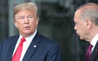 epa06880701 US President Donald J. Trump (L) talks to Turkey's President Recep Tayyip Erdogan (R) at NATO headquarters in Brussels, Belgium, 11 July 2018. NATO countries' heads of states and governments gather in Brussels for a two-day meeting.  EPA/TATYANA ZENKOVICH / POOL