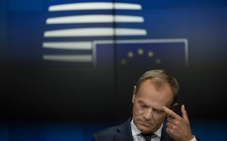 European Council President Donald Tusk touches his eyebrow after delivering a statement during a joint news conference following a Tripartite Social Summit roundtable at the European Council headquarters in Brussels, Tuesday, Oct. 16, 2018. (AP Photo/Francisco Seco)