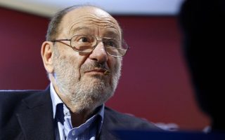 (FILES) This file photo taken on May 12, 2015 shows Italian author Umberto Eco during signing of his novel