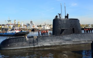 FILE PHOTO: The Argentine military submarine ARA San Juan and crew are seen leaving the port of Buenos Aires, Argentina June 2, 2014. Picture taken on June 2, 2014. Argentine Navy/Handout via REUTERS ATTENTION EDITORS - THIS IMAGE WAS PROVIDED BY A THIRD PARTY.
