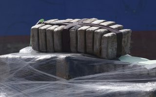 Bundles of cocaine which were later offloaded are seen on the the Coast Guard Cutter James, Tuesday, March 28, 2016, at Port Everglades in Fort Lauderdale, Fla.  The drugs were seized along Central and South America by the U.S. Coast Guard and the HMCS Saskatoon, which joined the operation in February.  (Joe Cavaretta/South Florida Sun-Sentinel via AP)