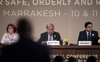 U.N. Secretary-General Antonio Guterres, flanked by Special Representative of the United Nations Secretary-General for International Migration, Louise Arbor, and Moroccan Minister of Foreign Affairs and International Cooperation, Nasser Bourita, right, reads his speech during the opening session of a UN Migration Conference in Marrakech, Morocco, Monday, Dec.10, 2018. Top U.N. officials and government leaders from about 150 countries are uniting around an agreement on migration, while finding themselves on the defensive about the non-binding deal amid criticism and a walkout from the United States and some other countries. (AP Photo/Mosa'ab Elshamy)