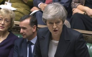 Britain's Prime Minister Theresa May speaks during the scheduled Prime Minister's Questions time in the House of Commons, in London, Wednesday Dec. 5, 2018. (Parliament TV / PA via AP)( / PA via AP)