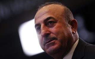 Turkish Foreign Minister Mevlut Cavusoglu waits for the start of a meeting of the North Atlantic Council and the Balkans at NATO headquarters in Brussels, Wednesday, Dec. 5, 2018. (AP Photo/Francisco Seco)