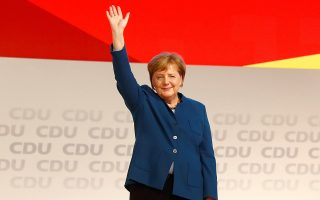German Chancellor Angela Merkel reacts during Christian Democratic Union (CDU) party congress in Hamburg, Germany, December 7, 2018. REUTERS/Fabrizio Bensch