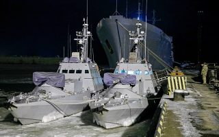 epa07204175 Two Ukrainian Gyurza-M class armored artillery patrol boats, one of them P178 Lubny  (L) moors in Mariupol, Ukraine, 02 December 2018. Germany, France, Ukraine and Russia will hold further talks at the advisor level about a shipping standoff in the Kerch Strait, German Chancellor Angela Merkel said on Saturday, 01 December, urging Moscow to let Ukrainian vessels enter the Sea of Azov as local media report.  EPA/SERGEY VAGANOV