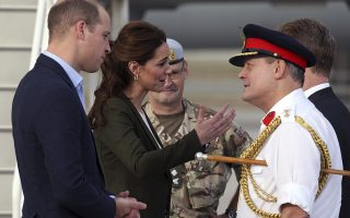 Britain's Prince William, left, and his wife Kate, the Duchess of Cambridge speak with army officials at the Akrotiri Royal Air Force base, near the south coastal city of Limassol, Cyprus, Wednesday, Dec. 5, 2018. The RAF Akrotiri is the home of the Cyprus Operations Support Unit which supplies support to operations in the region to protect the UK's strategic interests. (AP Photo/Petros Karadjias)