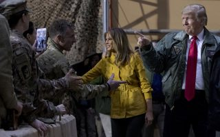President Donald Trump and first lady Melania Trump greet members of the military at a hanger rally at Al Asad Air Base, Iraq, Wednesday, Dec. 26, 2018. (AP Photo/Andrew Harnik)