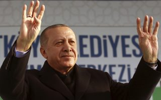 Turkey's President Recep Tayyip Erdogan addresses a meeting of his ruling Justice and Development Party, in Istanbul Sunday, Dec. 23, 2018. Israeli Prime Minister Benjamin Netanyahu is deepening a dispute with Erdogan, calling him Sunday an