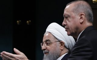 Turkey's President Recep Tayyip Erdogan, right, gestures to Iran's President Hassan Rouhani, as they arrive for a news conference following their meeting at the Presidential Palace in Ankara, Thursday, Dec. 20, 2018. Rouhani said Tehran and Ankara are determined to continue cooperating in efforts to bring peace to Syria, a day after U.S. President Donald Trump announced his decision to pull out American troops from Syria, after declaring victory over the Islamic State group. (AP Photo/Burhan Ozbilici)