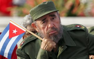 Cuban President Fidel Castro listens to a speaker during the May Day parade on Havana's Revolution Square in this May 1, 2005 file photo. Ailing Cuban leader Fidel Castro, who has not been seen in public for 16 months, suggested on December 18, 2007 he might give up his formal leadership posts -- the first time he has spoken of his possible retirement since he fell ill.     REUTERS/Claudia Daut/Files (CUBA)