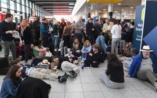 epa07242327 Passengers wait within Gatwick airport in Sussex, southeast, England, 20 December 2018. According to media reports, the runway for Britain's second busiest airport Gatwick was shut down by authorities after sightings of drones flying near the area. The incident disrupted air traffic and caused the suspension of all flights in and out of the airfield, with 110,000 passengers on 760 flights were due to fly from Gatwick.  EPA/FACUNDO ARRIZABALAGA