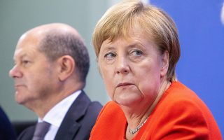 epa07037188 (L-R) Minister of Finance Olaf Scholz and German Chancellor Angela Merkel attend a press conference after the summit on living in the Chancellery, Berlin, Germany, 21 September 2018. The meeting aims to provide helping alternatives to tenants with little resources.  EPA/OMER MESSINGER