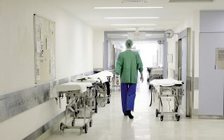 A doctor walks through an almost deserted floor of the surgery station at the Univerity Hospital in Bonn, western Germany, Thursday, March 16, 2006. Doctors at German public hospitals went on strike Thursday, staging protests expected to restrict non-urgent care and underline their demands for higher pay. The strike was to start at hospitals attached to universities in cities including Munich, Heidelberg and Bonn, and would spread to other clinics next week. Emergency services and intensive care are maintained. (AP Photo/Hermann J. Knippertz)