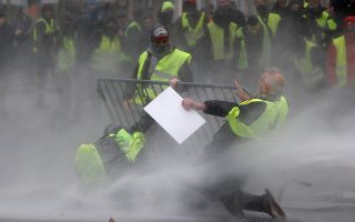 Protesters wearing yellow vests, a symbol of a drivers' protest against higher fuel prices, face off with police during clashes in central Brussels, Belgium, November 30, 2018. REUTERS/Yves Herman