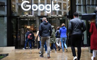 People outside the Google offices in Granary Sqaure, London, Thursday Nov. 1, 2018. Hundreds of Google engineers and other workers walked off the job Thursday morning to protest the internet company's lenient treatment of executives accused of sexual misconduct. Employees were seen staging walkouts at offices in Tokyo, Singapore, London, and Dublin. (Stefan Rousseau/PA via AP)