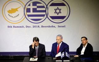 Israeli Prime Minister Benjamin Netanyahu sits next to Cypriot President Nicos Anastasiades and Greek Prime Minister Alexis Tsipras as the three leaders deliver joint statements at Carasso Science Park in Beersheba, Israel December 20, 2018. REUTERS/Amir Cohen