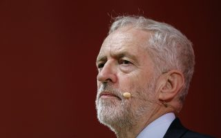 Britain's Labour Party leader Jeremy Corbyn pauses while delivering a speech at the Party of European Socialists congress in Lisbon, Portugal, Friday, Dec. 7, 2018. (AP Photo/Pedro Rocha)