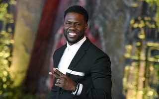 FILE - In this Dec. 11, 2017 file photo, Kevin Hart arrives at the Los Angeles premiere of