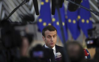 French President Emmanuel Macron arrives for an EU summit in Brussels, Thursday, Dec. 13, 2018. EU leaders gather Thursday for a two-day summit which will center on the Brexit negotiations. (AP Photo/Francisco Seco)