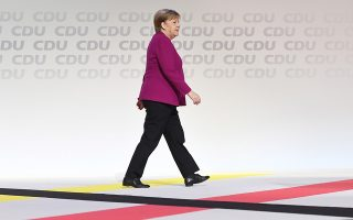 epa07216166 German Chancellor Angela Merkel arrives for the second day of the 31st Party Congress of the Christian Democratic Union (CDU) in Hamburg, Germany, 08 December 2018. Former CDU General-Secretary Annegret Kramp-Karrenbauer (unseen) was elected as the new CDU chairwoman on 07 December with the debate going on over the fundamental political orientation of the CDU after Chancellor Merkel will no longer hold this office.  EPA/DAVID HECKER