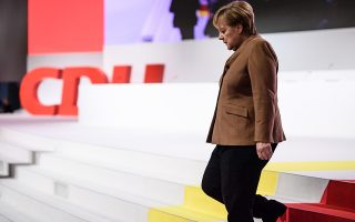 epa07212283 German Chancellor Angela Merkel walks down the stairs of the plenum as she visits the venue of the 31st Party Congress of the Christian Democratic Union (CDU) in Hamburg, Germany, 06 December 2018. At the party congress, a new party chairwoman or chairman is to be elected on 07 December 2018. Associated with the election is the debate over the fundamental political orientation of the CDU after Chancellor Merkel will no longer hold this office.  EPA/CLEMENS BILAN