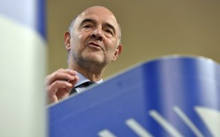European Commissioner for Economic and Financial Affairs Pierre Moscovici speaks during a media conference at EU headquarters in Brussels, Wednesday Dec. 5, 2018. The European Commission on Wednesday presented actions to strengthen the role of the euro in a changing world. (AP Photo/Geert Vanden Wijngaert)