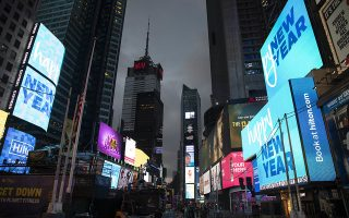 Billboards welcome in the new year in New York's Times Square, Monday, Dec. 31, 2018. (AP Photo/Mark Lennihan)