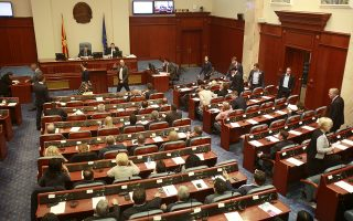Lawmakers gather on an urgent session, in the Parliament building in Macedonia's capital Skopje, on Wednesday, May 18, 2016. Macedonian lawmakers on Wednesday convened in an urgent session on whether to delay a general election scheduled for June 5, after the Constitutional Court temporarily suspended all electoral activities. (AP Photo/Boris Grdanoski)