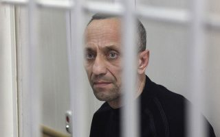 epa07221375 (FILE) - Former police officer Mikhail Popkov during a verdict announcement at the Irkutsk Regional Court in the city of Irkutsk, eastern Siberia, Russia, 14 January 2015 (reissued 10 December 2018). The convicted rapist and serial killer Mikhail Popkov, who was sentenced to life for killing 22 women during a six-year period from 1994 to 2000, was given an additional life sentence 10 December 2018   for 56 additional killings.  EPA/DMITRY DMITRIYEV